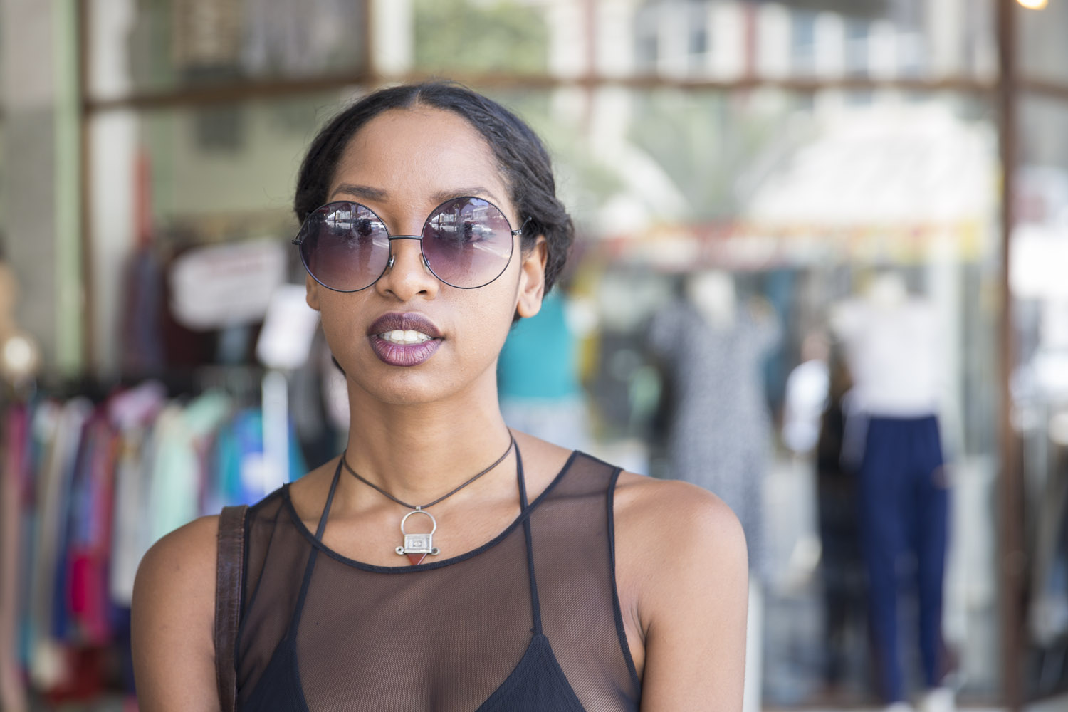 Bianca wears a thrifted outfit and a necklace from South Africa.