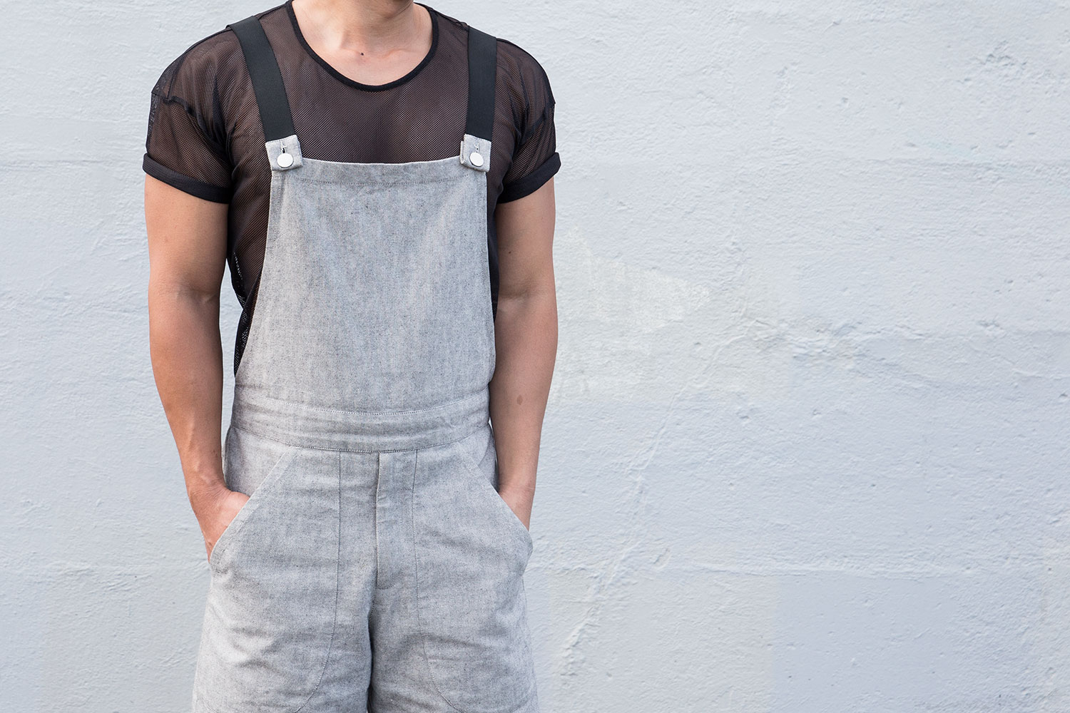 Chin wears ASOS t shirt, Zambesi overalls, Nom D socks and Dr. Martens shoes.