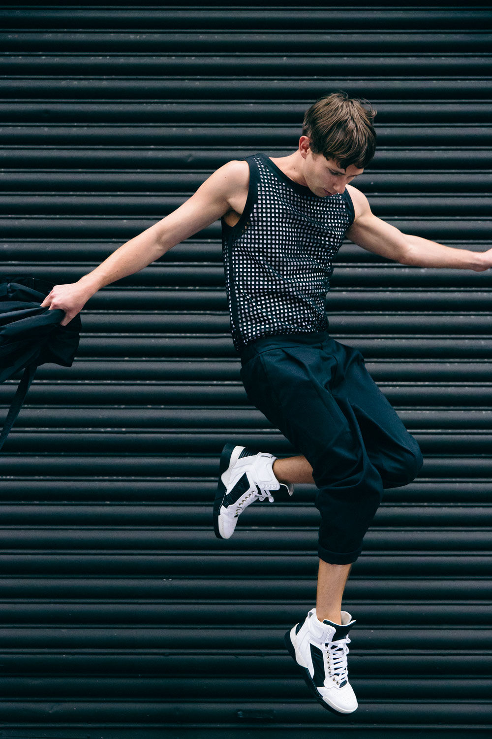 Danny wears a Witchery tank, Kowtow pants and Gvenchy trainers.