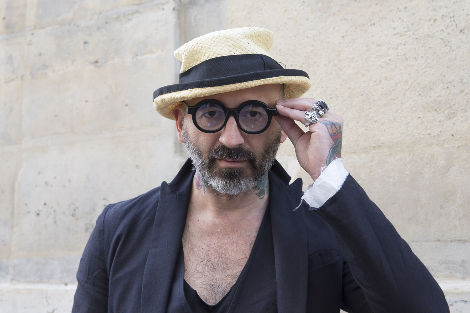 Marc wears clothes, hat and rings by Nostra Santissima, and glasses by Kuboraum.