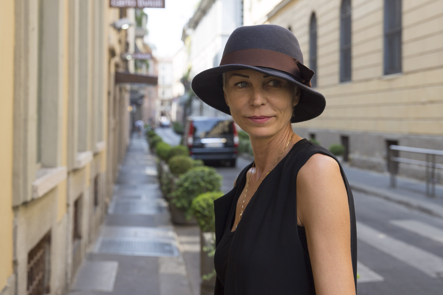 Natalia wears vest by Ilaria Nistri and hat by Nostra Santissima.