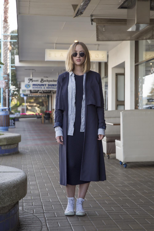 Ngaire wears Blak Love coat, Claude Maus shirt, Penny Sage knit dress and Converse shoes.