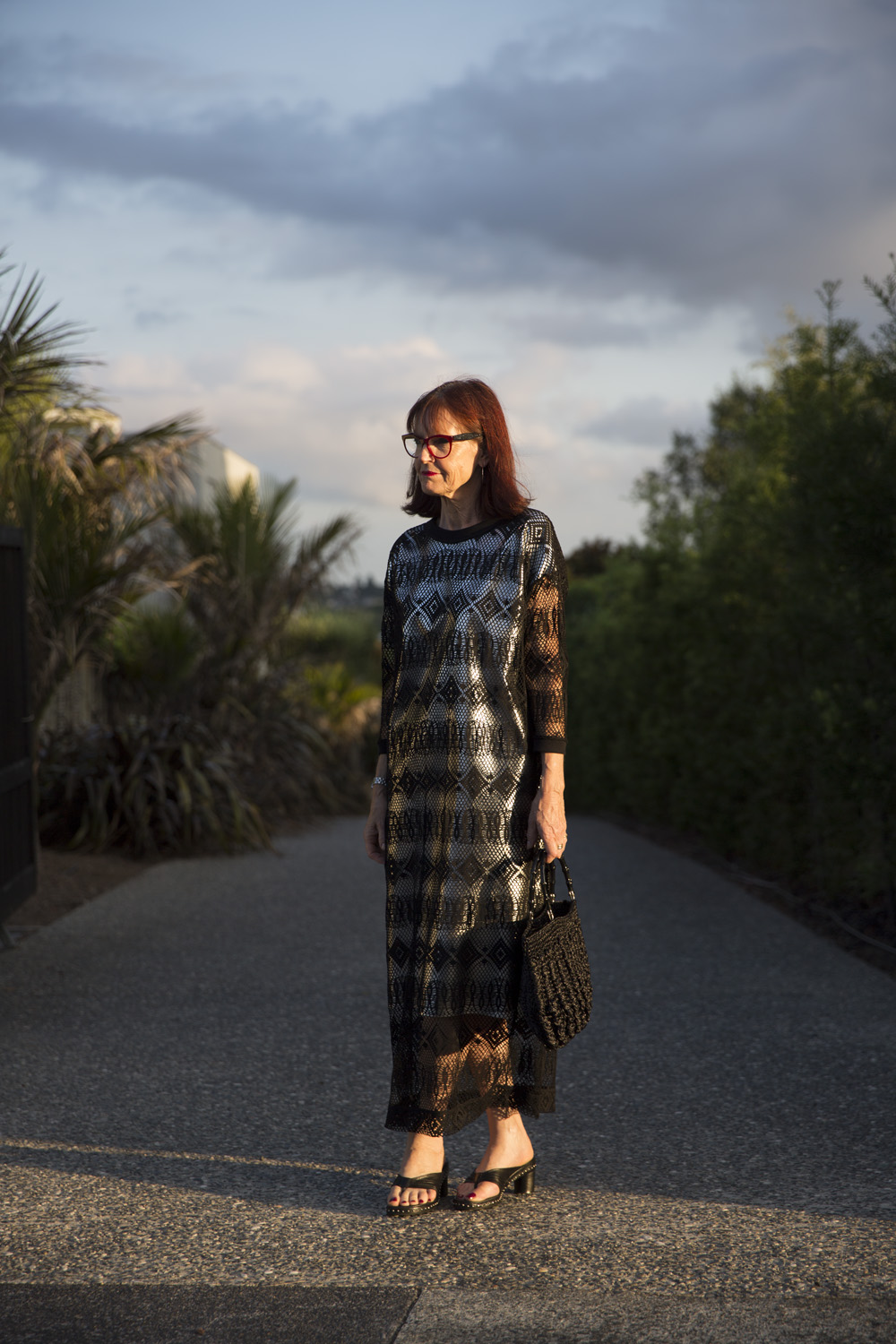 Mary Anne wears Pardon My French dress over a self-made dress, Charles Jourdan shoes, Miu Miu spectacles and self-made bag.