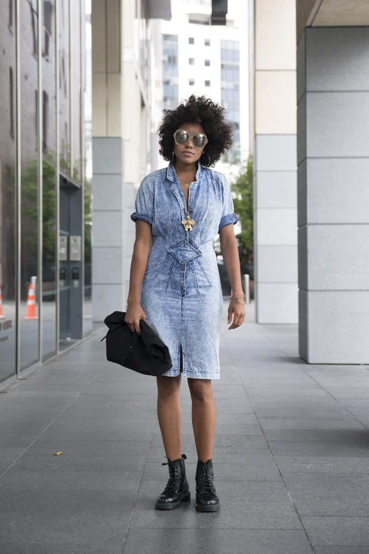 Amber wears dress from an Op shop, Dr. Martens shoes, Karen Walker sunglasses and Topshop bag.