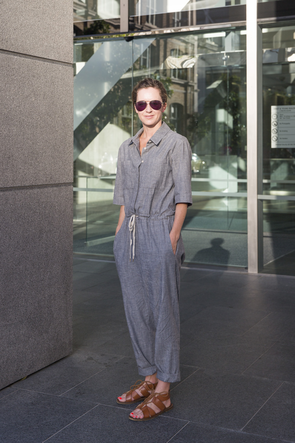 Anna wears jumpsuit by Juliette Hogan, sandals by Windsor Smith and Sass and Bide sunglasses.